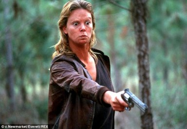 Charlize Theron in Monster holding a gun