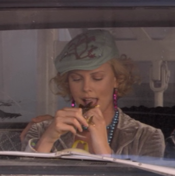 Rita (Charlize Theron) in Arrested Development gets her prize chocolate